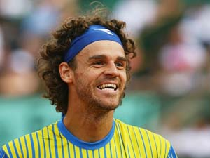 Vencer Roland Garros me surpreende at� hoje, diz Guga