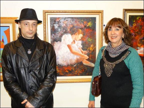 O curador Carlos Zemek e a artista pl�stica Liane Maria.
