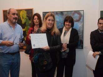 Alejandra Paula representou o artista Carlos Zemek. A seu lado o galerista Roberto Gonz�lez.