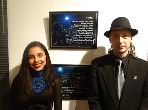 Fotografia de Luid Ferreira. - A poetisa Juliana Oliveira Nascimento e o curador CArlos Zemek