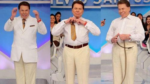 Silvio Santos reprova figurino e tira parte da roupa no palco